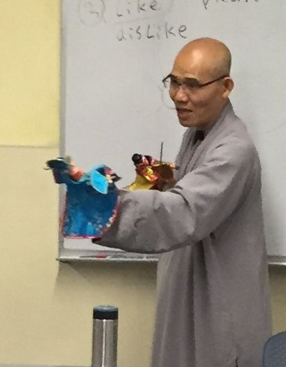 Guo Xin with puppets